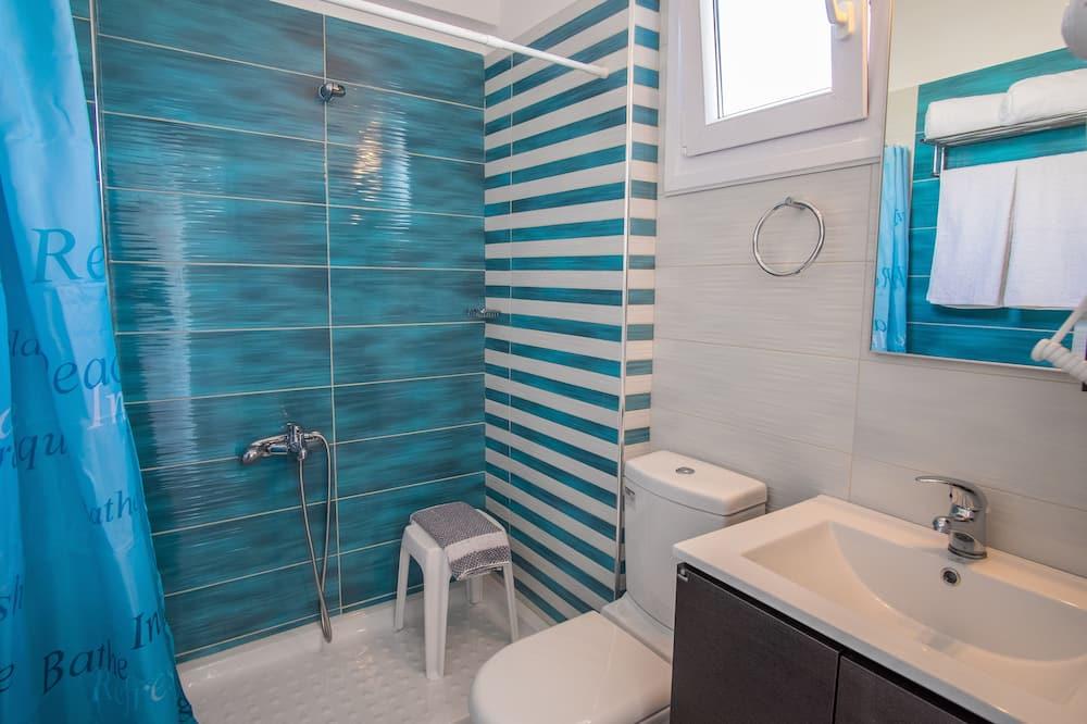 Habitación Deluxe con 1 cama doble o 2 individuales, vista parcial al mar - Baño