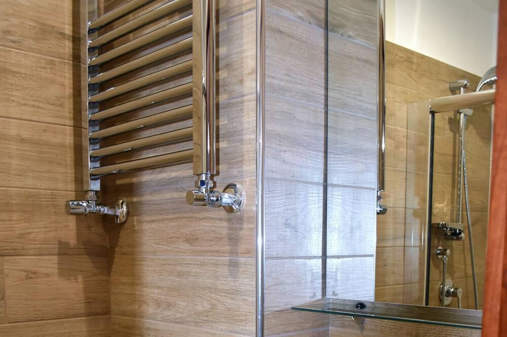 Habitación Confort con 1 cama doble o 2 individuales - Cuarto de baño