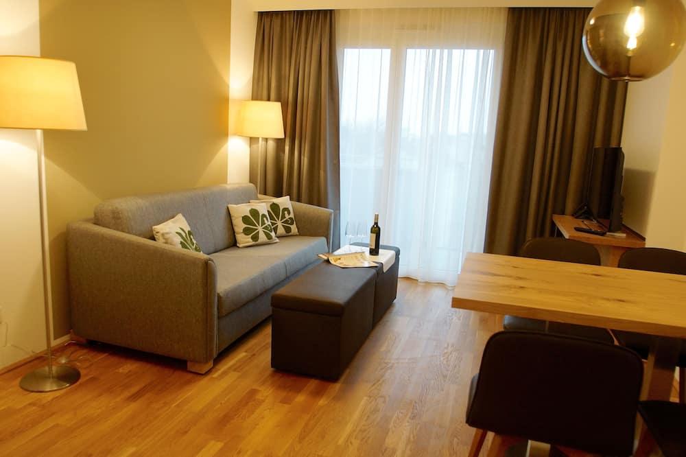 Apartemen Deluks, balkon, pemandangan kebun - Area Keluarga