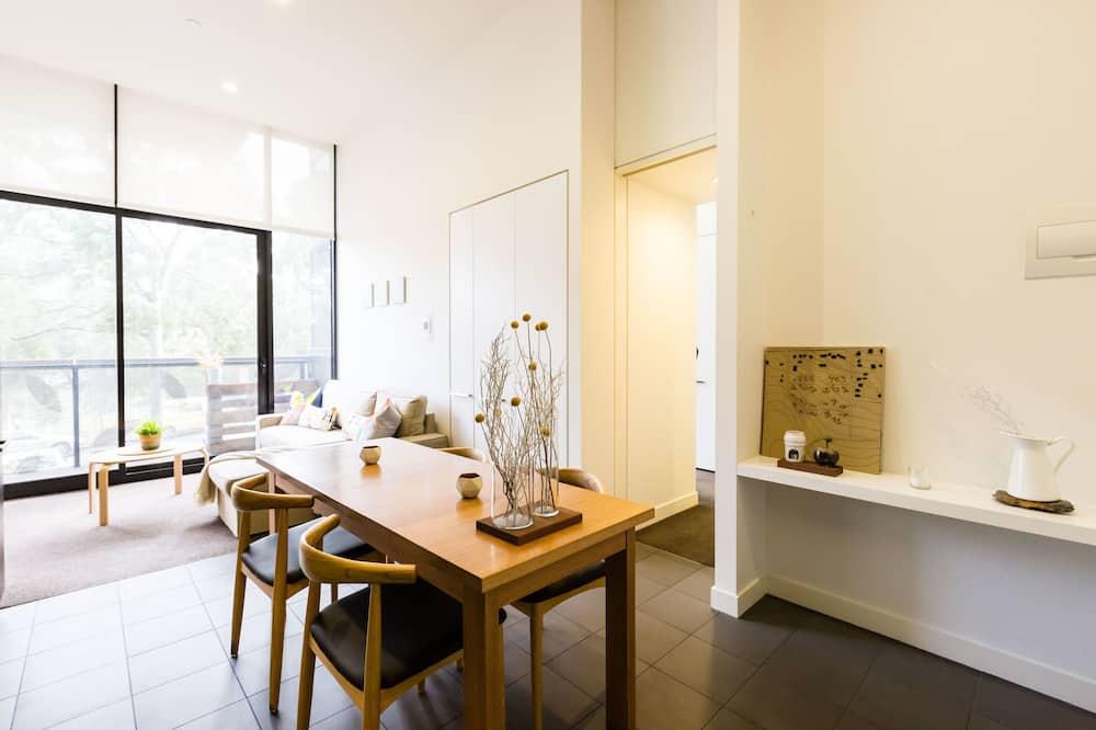 Premium appartement, 1 slaapkamer - Eetruimte in kamer
