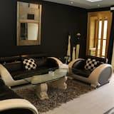 Executive suite with Jacuzzi balcony and sea view - Área de Estar