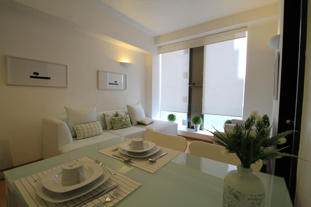 Comfort appartement - Eetruimte in kamer