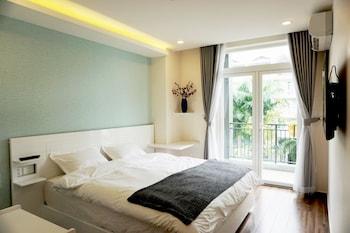 Fotografia hotela (Shinhua Hotel) v meste Hočiminovo mesto