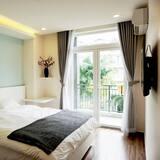 Doppia Deluxe, 1 letto king, balcone, vista città - Camera