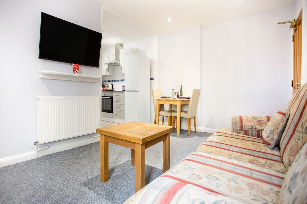Suite superior, 1 cama doble - Sala de estar