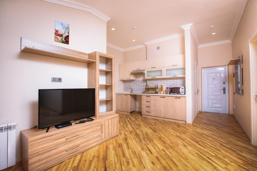 דירת ביזנס, מיטת קינג וספה נפתחת, מטבח - אזור מגורים