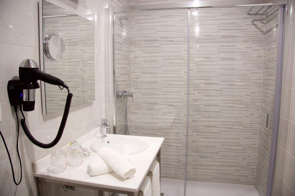 Phòng đôi, 2 giường đơn - Bồn tắm vòi sen trong phòng tắm