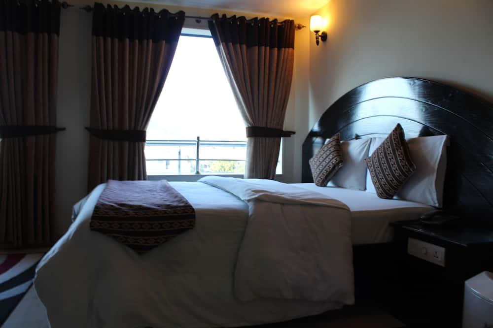 חדר דה-לוקס זוגי או טווין, נוף להר - חדר אורחים