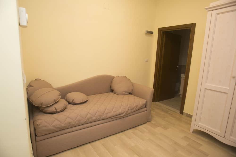 Singola Comfort, bagno in camera, vista cortile - Area soggiorno