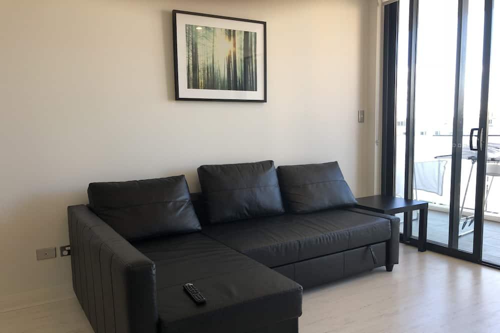 Standaard appartement, 2 slaapkamers, Toegankelijk voor mindervaliden, Uitzicht op de stad - Woonkamer