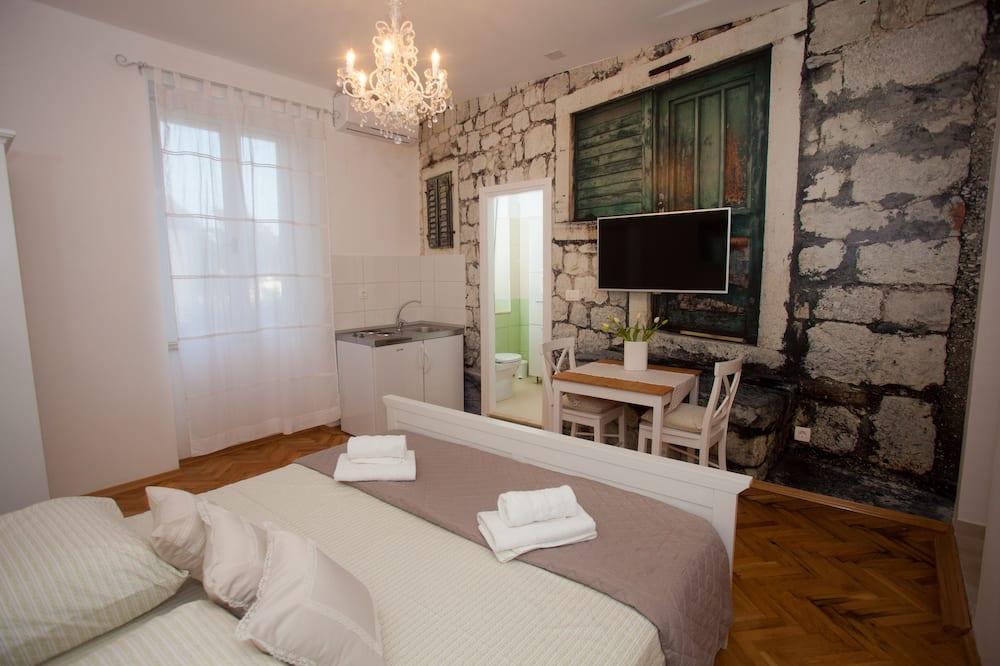 Studio Deluxe, 1 très grand lit - Chambre