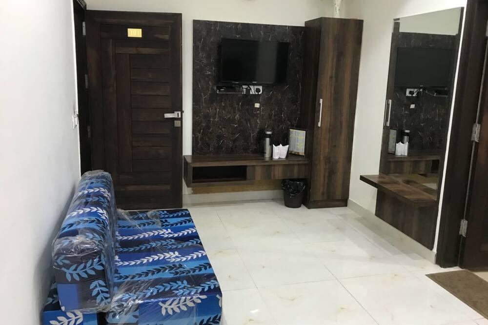 Deluxe-værelse til 3 personer - Opholdsområde