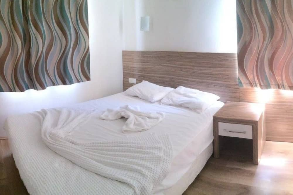 Стандартный двухместный номер с 1 двуспальной кроватью - Номер