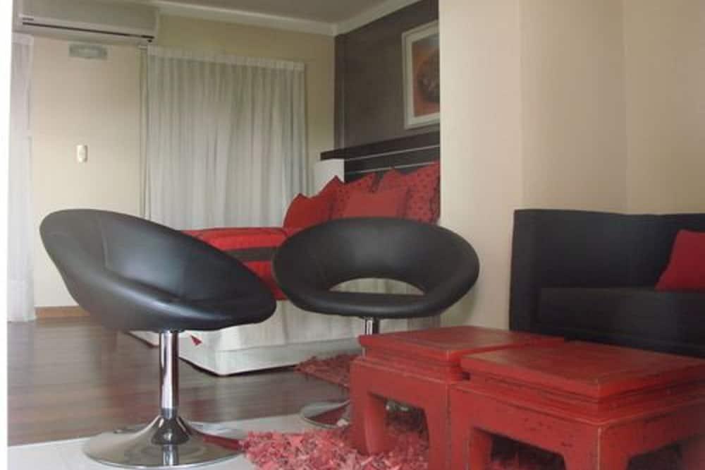 Suite, 1 cama King size (Jacuzzi y Terraza privada) - Sala de estar