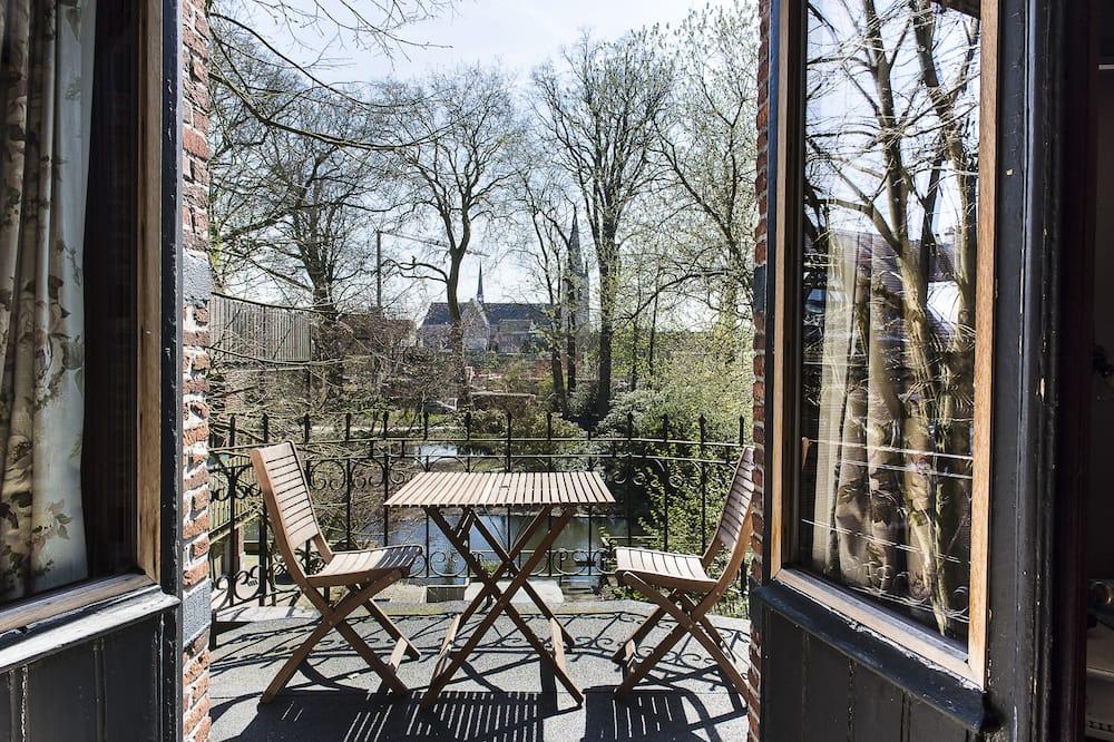 Habitación Deluxe con 1 cama doble o 2 individuales, con acceso para silla de ruedas, vista al patio - Vista al jardín