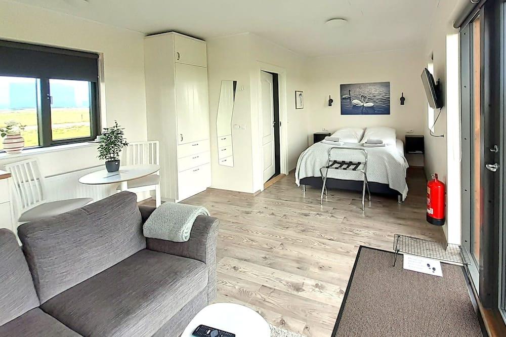 Panoramic-Ferienhütte, 1 Queen-Bett, Kochnische, Seeblick - Wohnbereich