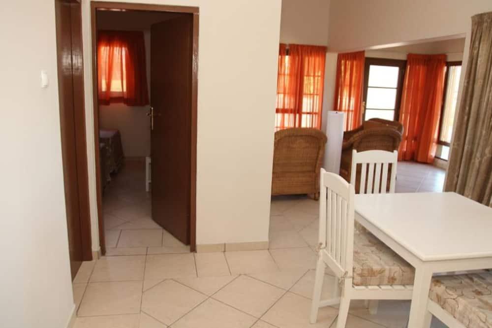 Standard Quadruple Room, 2 Bedrooms - Living Area