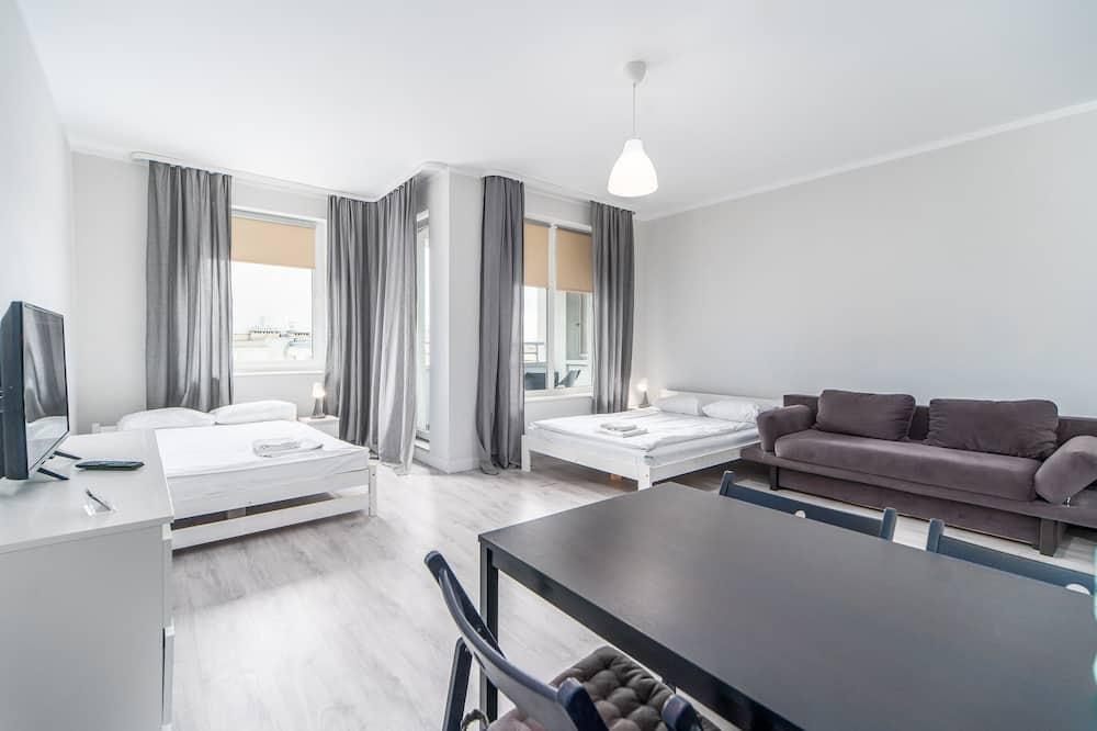 Habitación cuádruple, 2 camas dobles, balcón - Sala de estar