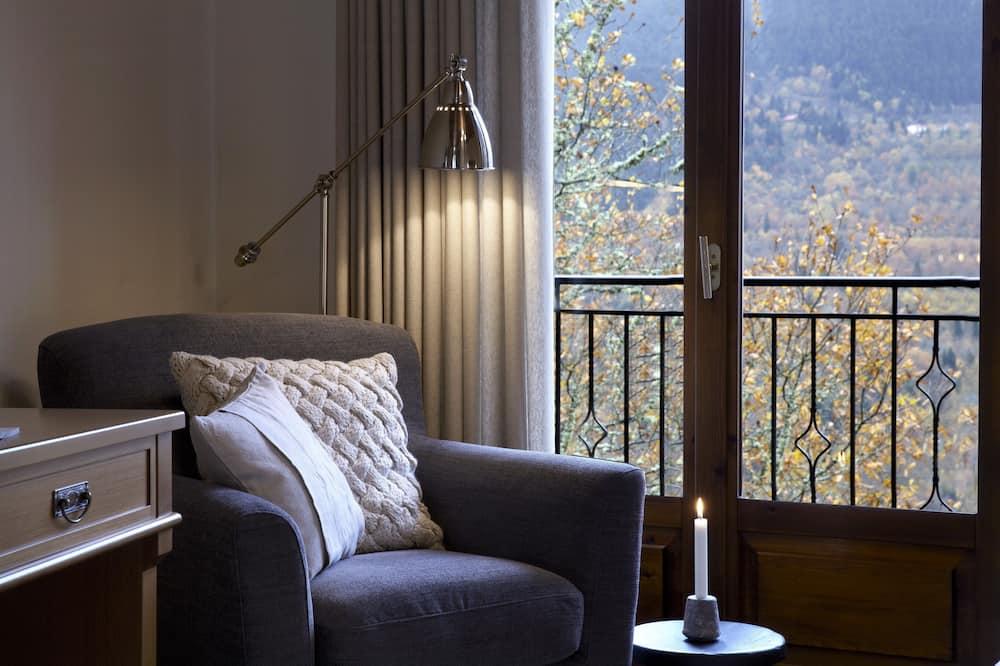 Camera doppia, caminetto - Area soggiorno