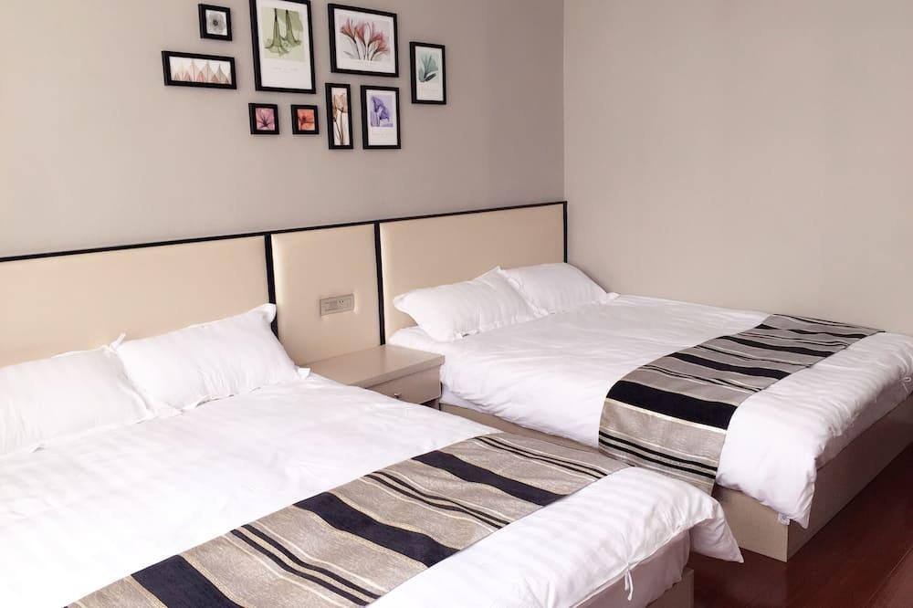 Habitación de diseño con 2 camas individuales - Habitación