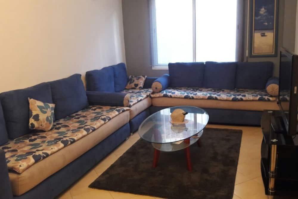 Superior-Apartment, 1Queen-Bett und Schlafsofa, Blick auf den Innenhof - Wohnzimmer
