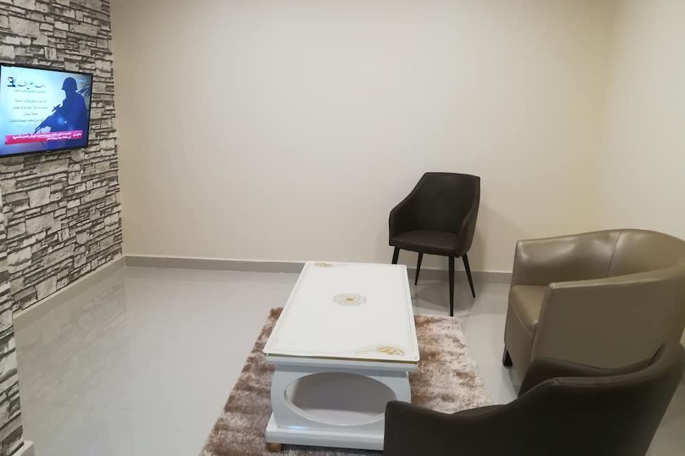 Apartament typu Deluxe Suite, Łóżko king, widok na góry - Salon