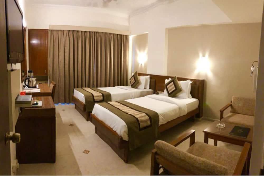 Darījumklases divvietīgs numurs vienai personai, divas guļamistabas, skats uz pilsētu - Dzīvojamā istaba