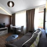 Loftový byt, kuchyně - Obývací pokoj