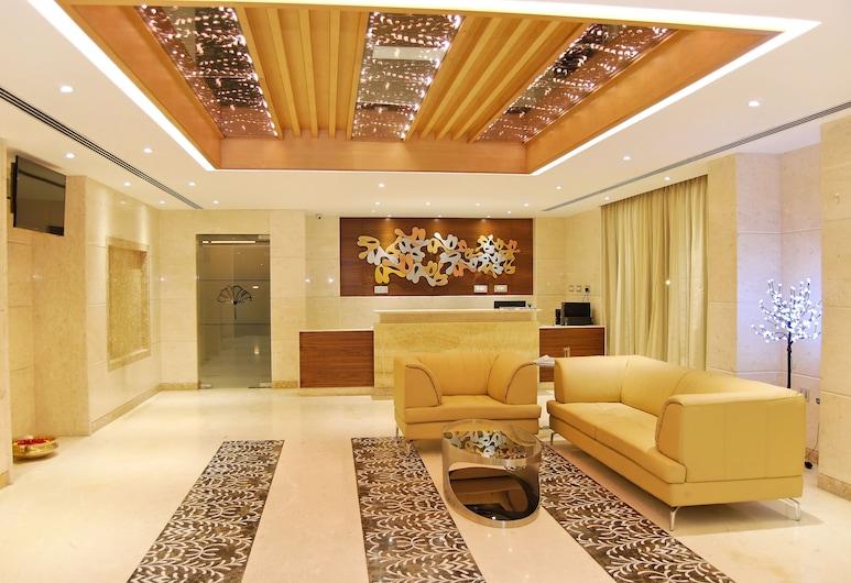 Poppys Anukula Residency - Vellore, Vellore, Siddeområde i lobby