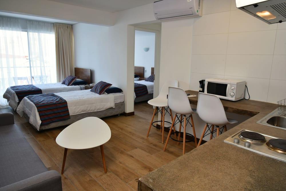 Familienapartment, Mehrere Betten - Wohnbereich