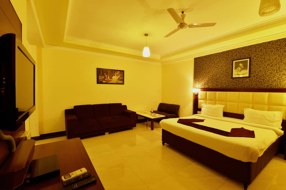 Habitación Deluxe con 1 cama doble o 2 individuales, 1 cama King size, para fumadores, refrigerador - Habitación