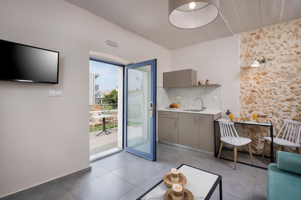 Dvojlôžková izba typu Deluxe, 1 veľké dvojlôžko, kuchynka - Obývacie priestory