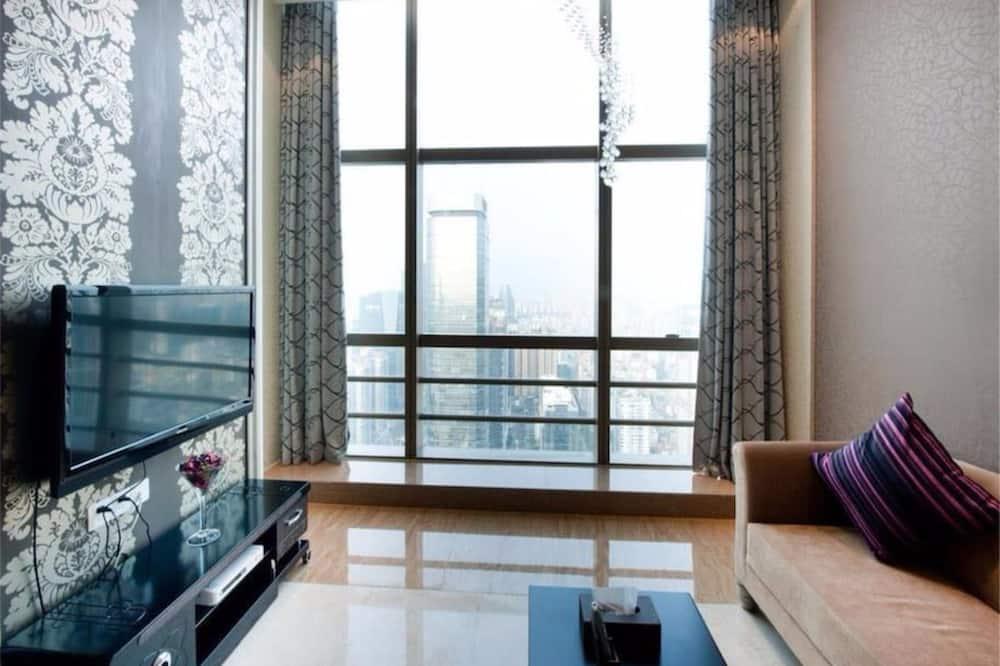 Romantische suite, 1 kingsize bed, Uitzicht op de stad, in toren - Woonruimte