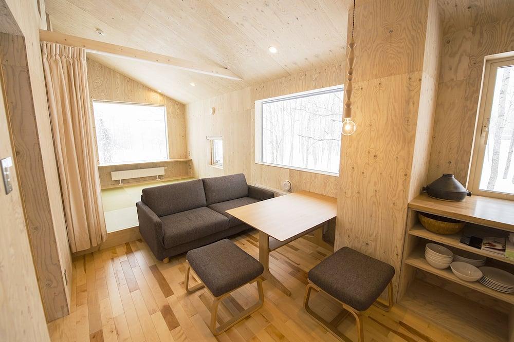 Ferienhaus (Private Vacation) - Wohnbereich
