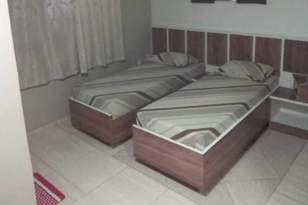 غرفة لفردين - حمّام