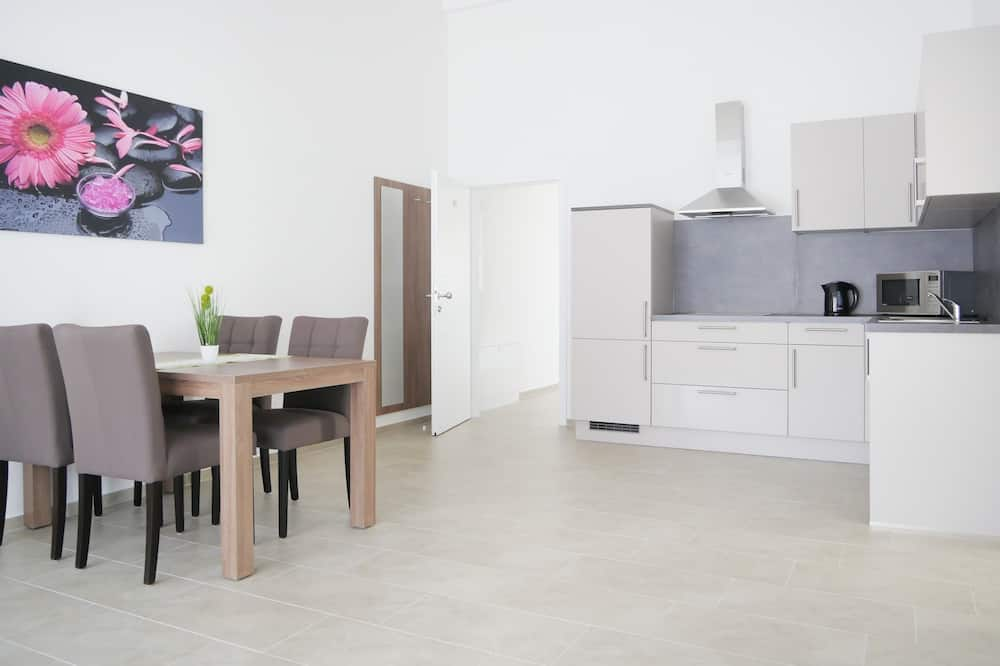 Family Apartment, 1 Bedroom, Non Smoking, Balcony - In-Room Dining