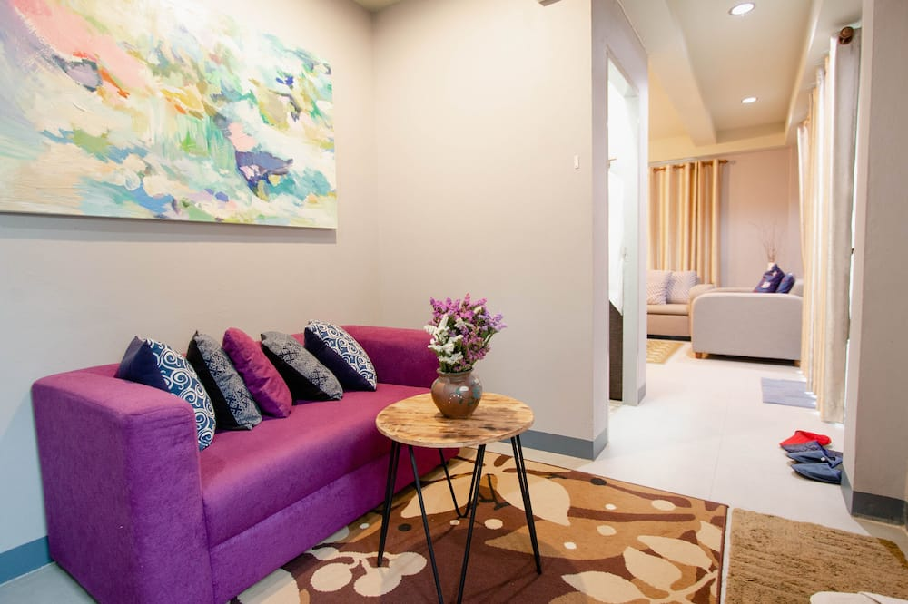 Deluxe Double or Twin Room, 4 Bedrooms - Living Room