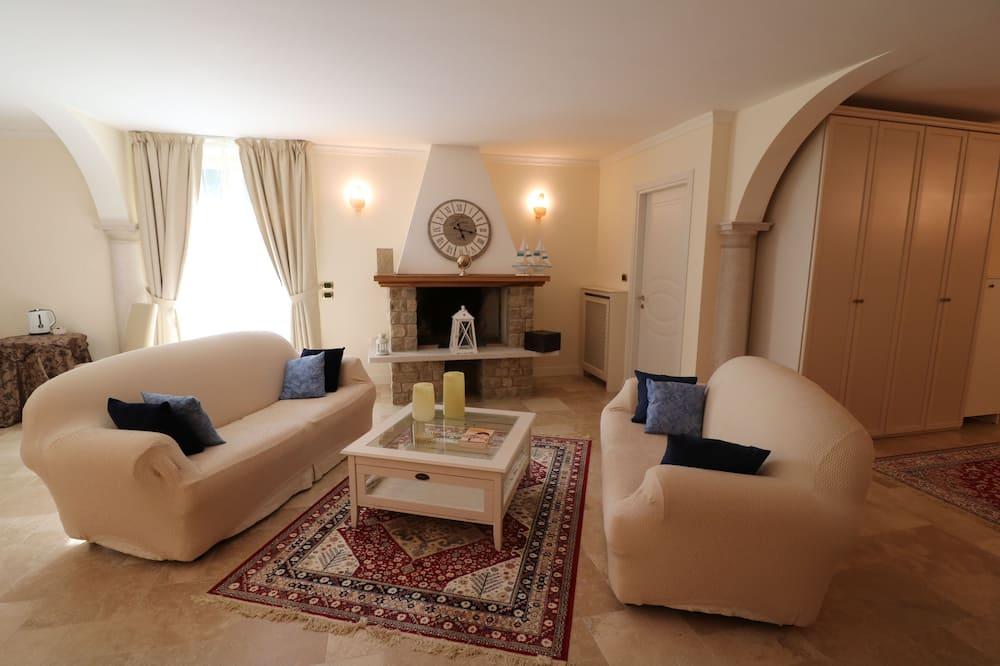 Apartmá typu Superior, výhled do zahrady - Obývací pokoj