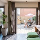 Perhetalo, 3 makuuhuonetta, Terassi, Näköala puutarhaan - Ruokailu omassa huoneessa