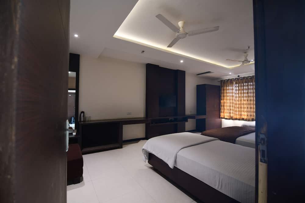 غرفة عائلية بسريرين منفصلين (Non AC) - غرفة نزلاء