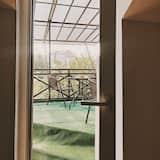 סוויטת סופריור, חדר שינה אחד, נוף לגן - מרפסת