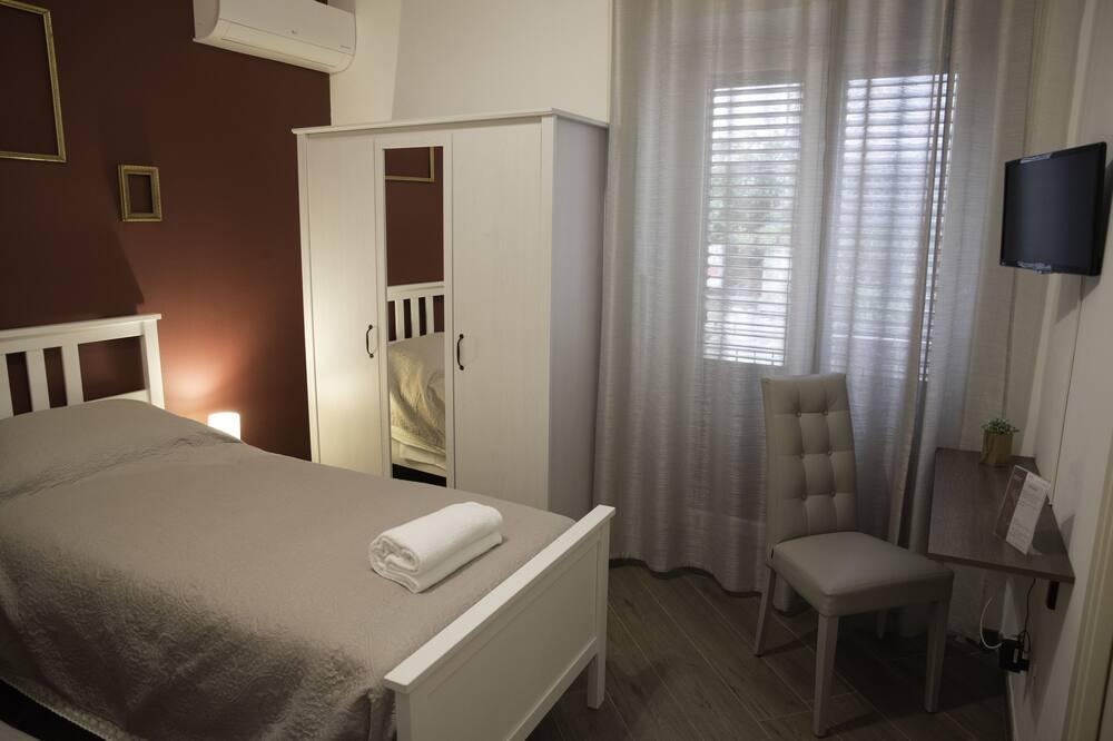 Comfort tvåbäddsrum - 2 enkelsängar - Balkongutsikt