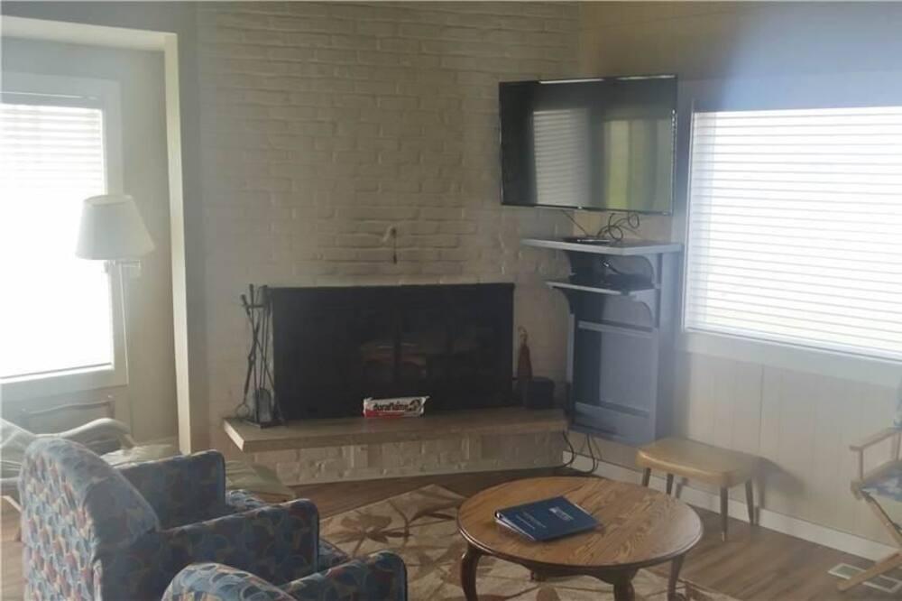 Lägenhet - 3 sovrum - eldstad - havsutsikt - Vardagsrum