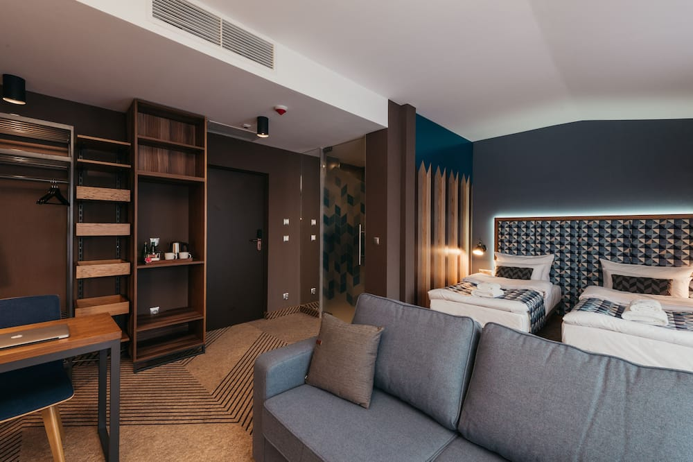 Superior-Doppel- oder -Zweibettzimmer - Wohnbereich