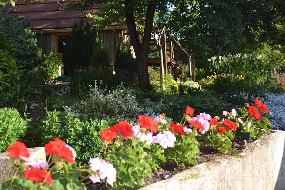 Rekreačná chata typu Comfort, 1 dvojlôžko, súkromná kúpeľňa, s výhľadom do záhrady - Výhľad na záhradu