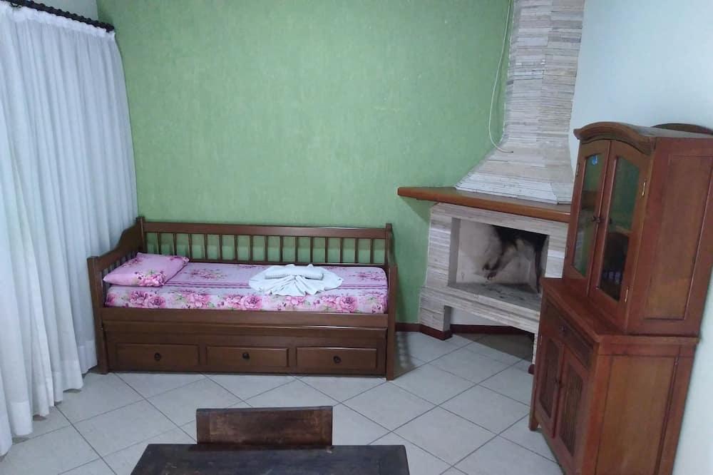 Apartamento Aconchego - غرفة معيشة