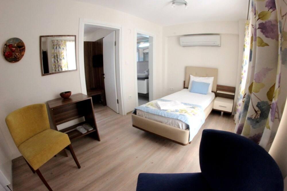 Třílůžkový pokoj typu Deluxe, 2 ložnice - Pokoj