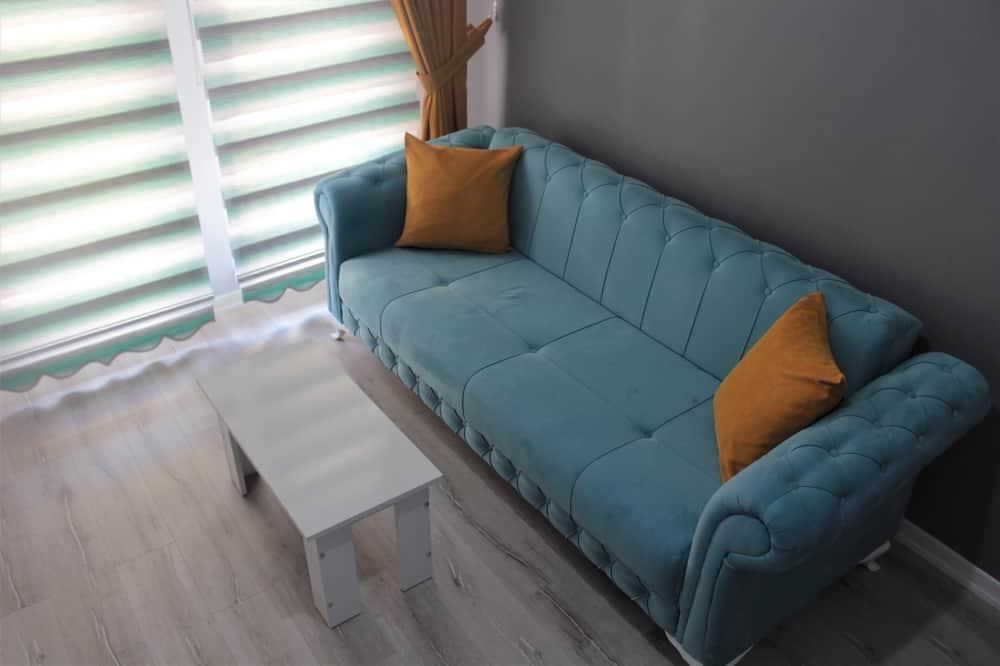 Familiekamer, 1 queensize bed met slaapbank - Woonkamer