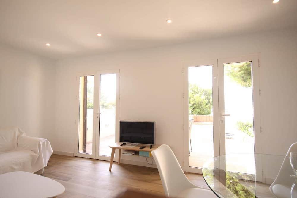 Бунгало категорії «Комфорт», 2 спальні, тераса, з видом на водойму - Вітальня