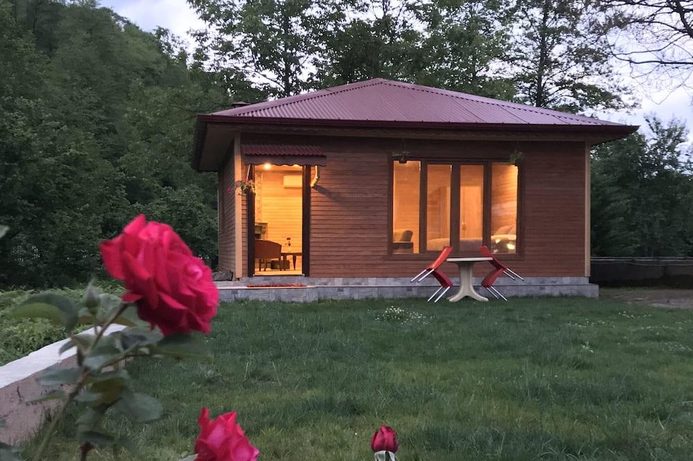 Poilsio namelis su patogumais, 1 miegamasis, vaizdas į kiemą, sodas - Svečių kambarys